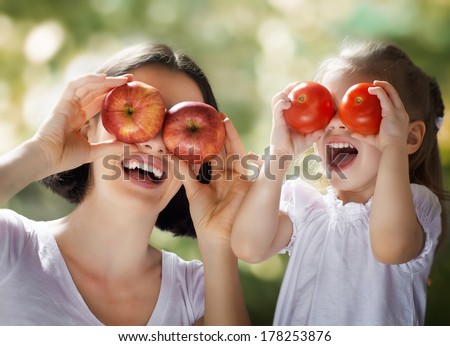 happy family keeps fresh vegetables - stock photo