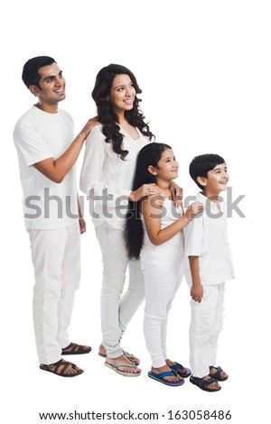 Happy family lined up shortest to tallest - stock photo