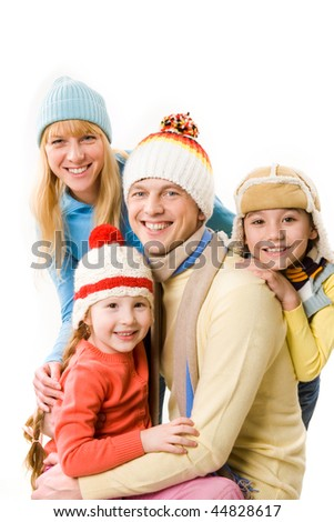 Happy family looking at camera with smiles