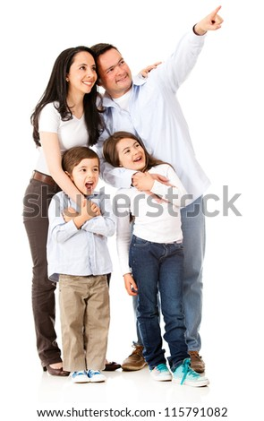Happy family looking away and pointing - isolated over white - stock photo