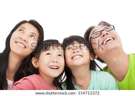 Happy family looking up - stock photo