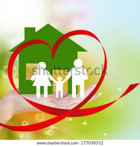 Happy Family.Love Concept.Hands holding a paper Home on abstract green background - stock photo
