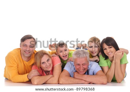happy family lying at floor on a white - stock photo