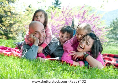 Happy family lying on a blanket - stock photo