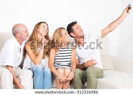 Happy family making a selfie with a phone