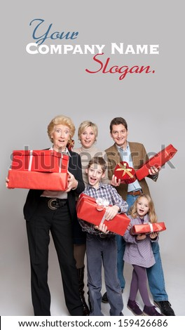 Happy family members holding gift boxes in different shapes - stock photo