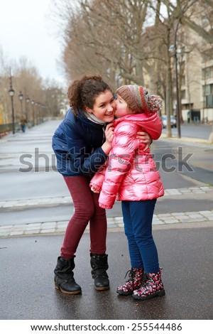 Happy family moments - girls having fun in the city - stock photo