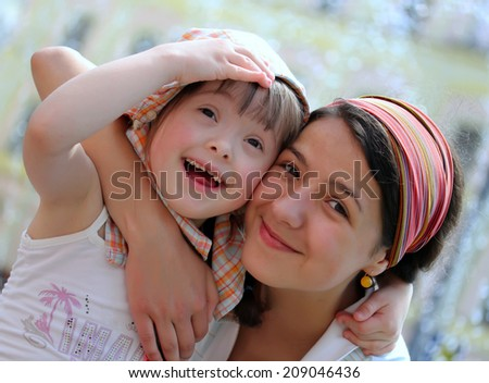 Happy family moments - Mother and child have a fun - stock photo
