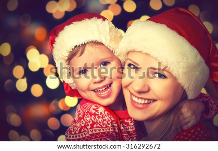 happy family mother and baby little child playing in the winter for the Christmas holidays - stock photo