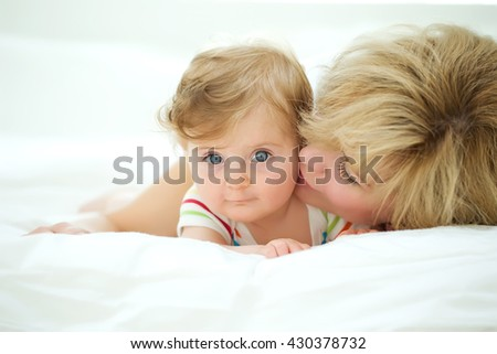 happy family. Mother and baby playing and smiling