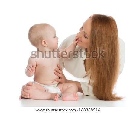 Happy family mother and child baby girl touching mom's face and hugging on white background