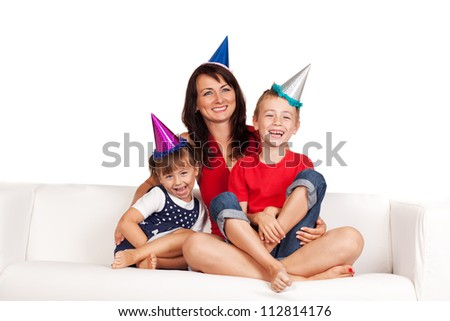 Happy family . Mother and children celebrating birthday at home - stock photo