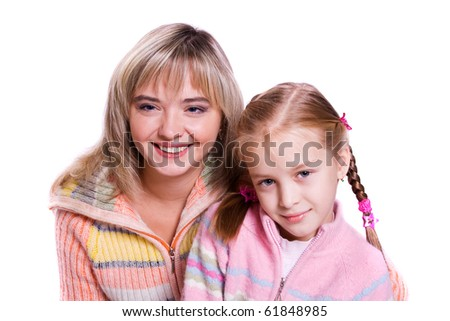 Happy family -  mother and daughter are embracing.