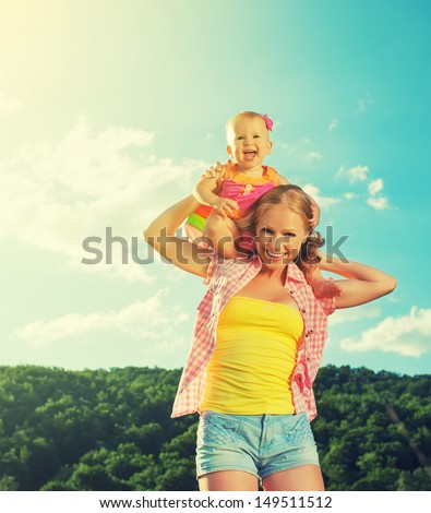 happy family. mother and daughter baby girl playing on nature outdoors