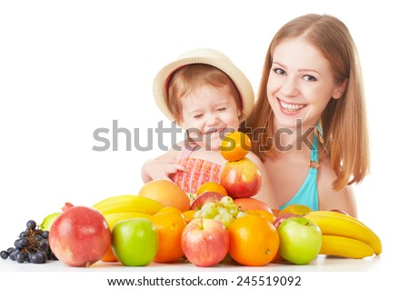 happy family mother and daughter little girl, eat healthy vegetarian food, lots of fruit isolated - stock photo