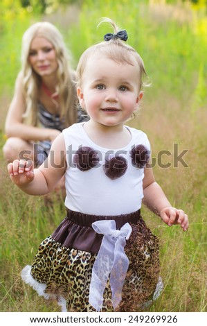 Happy family mother and daughter on nature - stock photo