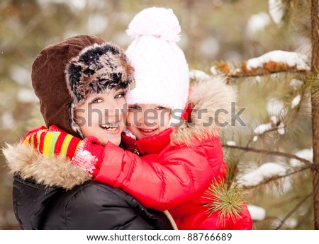 happy  family; mother and daughter  outdoor on a warm winter day - stock photo