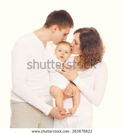 Happy family mother and father kissing baby on white background - stock photo