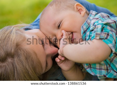 happy family, mother and sun - stock photo