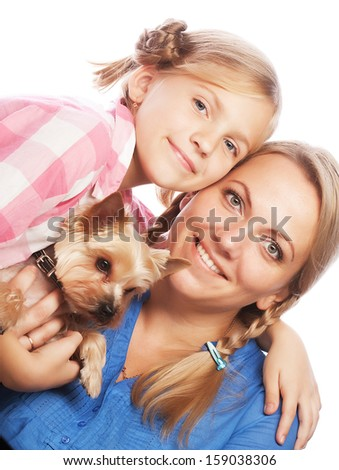 Happy family mother daughter and Yorkshire Terrier isolated on white