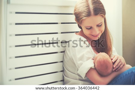 happy family. mother embracing her newborn baby - stock photo