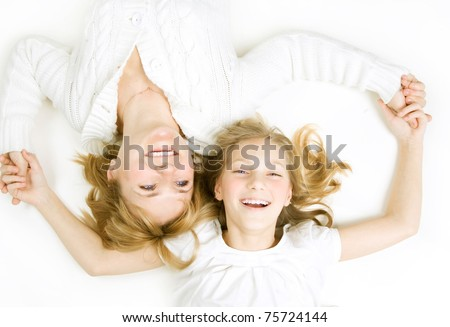 Happy Family. Mother with teenage Daughter over white