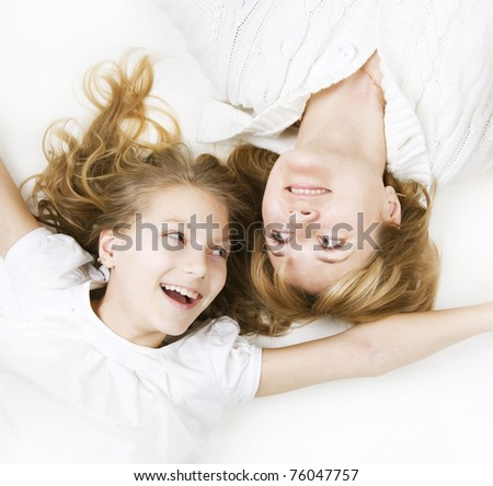 Happy Family. Mother with teenage Daughter over white - stock photo