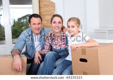 Happy family moving in new house - stock photo