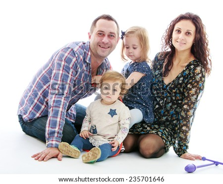Happy family mum dad and two daughters.Isolated on white background. - stock photo