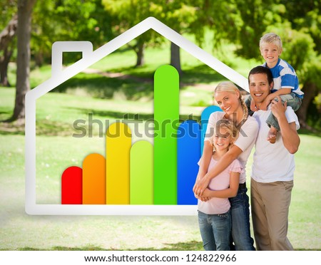 Happy family near to an energy effiecient house illustration in the park - stock photo