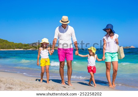 Happy family of four during beach vacation - stock photo
