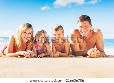 Happy Family of Four on Tropical Beach, Summer Lifestyle - stock photo