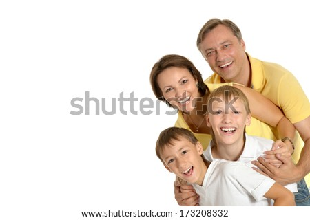 Happy family of four standing on white background - stock photo