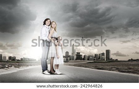 Happy family of mother father and daughter - stock photo