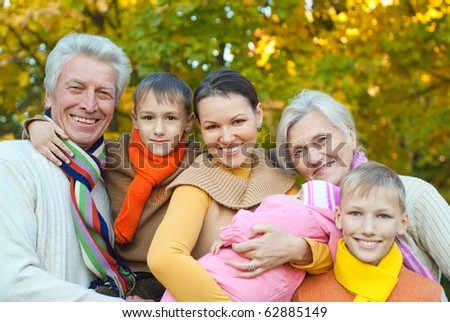 happy family of six on the nature