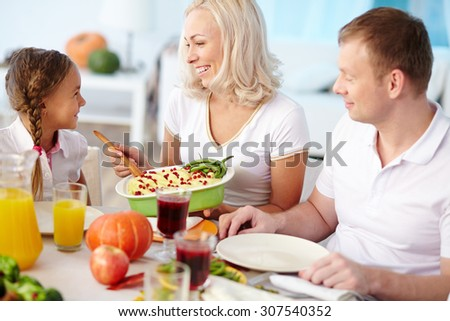 Happy family of three dining together - stock photo