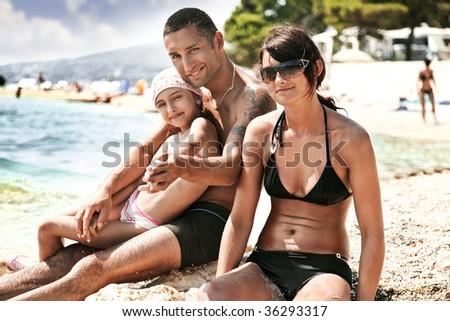 Happy family on a ocean coast - stock photo