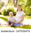 Happy family on green grass  - stock photo