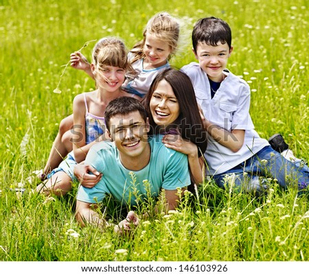 Happy family on green grass.Outdoor.
