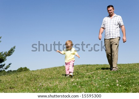 happy family on green meadow