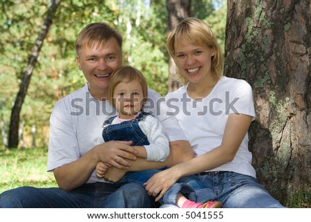happy family on nature - stock photo