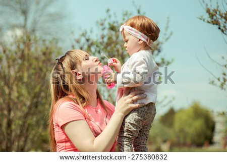 Happy Family On Nature Mother And Baby Daughter - stock photo