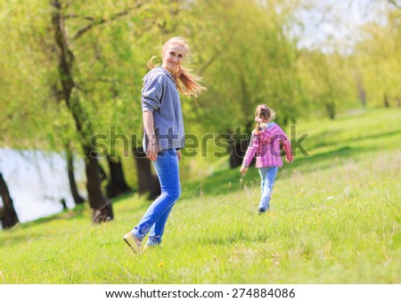 Happy family on nature walks in the summer