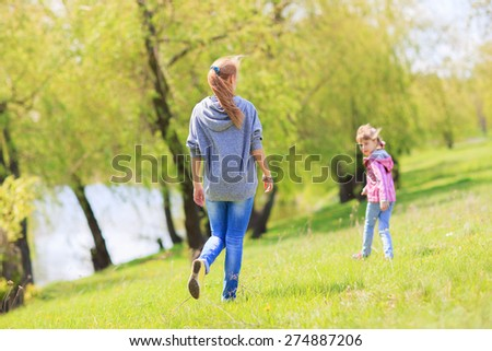 Happy family on nature walks in the summer - stock photo