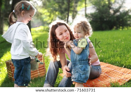 Happy family on picnic in summer park - stock photo