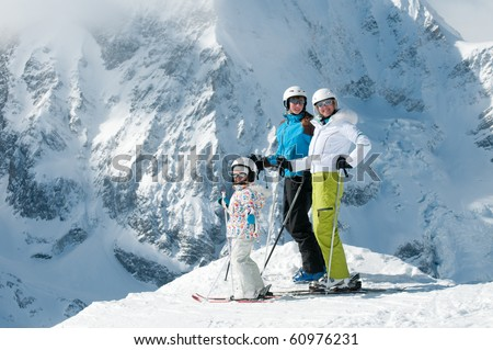 Happy family on ski - stock photo