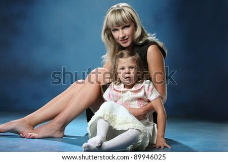 happy family on studio shooting - stock photo