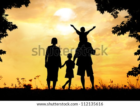 Happy family on sunset in nature