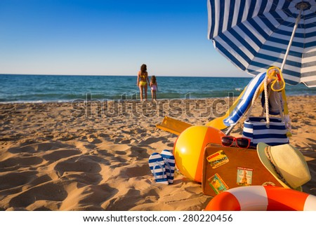 Happy family on the beach. Summer vacation concept. Focus on foreground