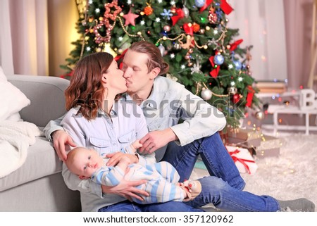 Happy family on the floor in the decorated Christmas room